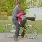 Gilda And Mr. Right on a bike